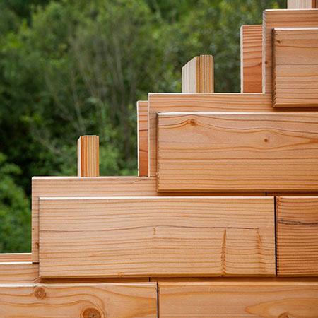Деревянный кирпич для строительства